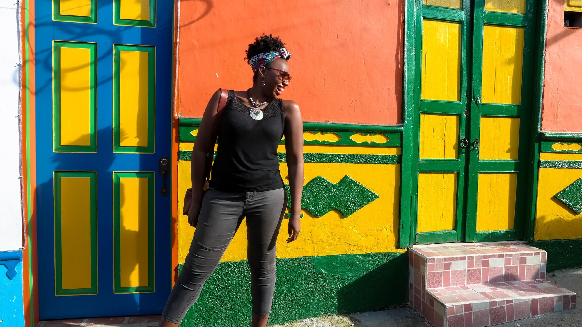 Black Woman Against Colorful Wall